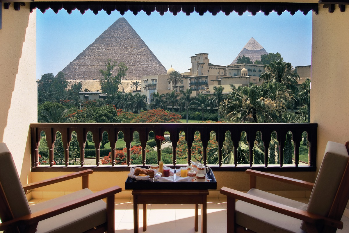 Admire Egyptian pyramids from Mena House Hotel